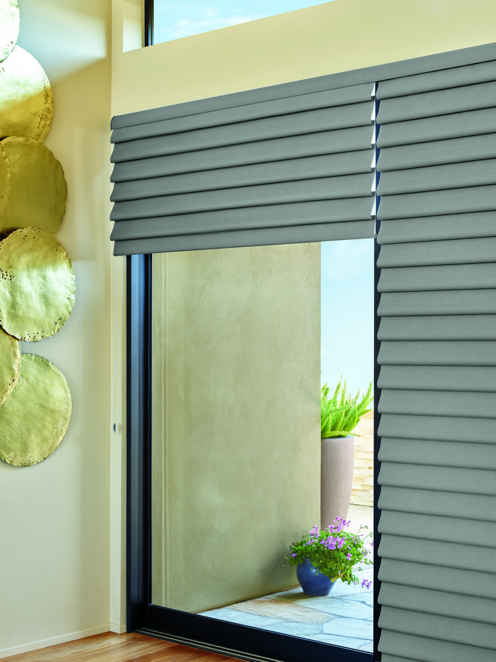 Modern Roman Shades - Uniform contoured or flat-fabric folds with no exposed rear cords align over our sliding glass door.  Now available with the Duo-Lite feature.Pros: When you want a roman shade for a patio door, do consider Modern Roman Shades.  Fabric folds are lighter and align easier for two-on-one applications.  Cons:  Modern Roman Shades do not provide all of the fabric selections and styles that a Custom Roman Shade will provide.  Option:  Bring the two together for one fabulous look.  Create a custom hobbled-style valance in any fabric of your choosing to go over your Modern Roman Shades. Voila!