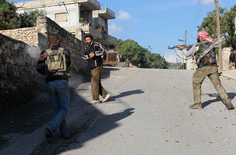 FSA fighters shoot a suspected regime colaborator