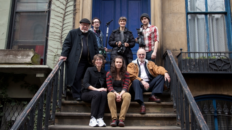The crew on the steps of the Brooklyn Heights brownstone where The Phantom Tollbooth was written