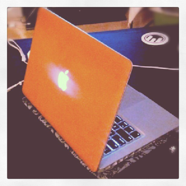 Brown leather Macbook skin.