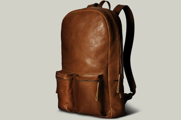 "mypantalones :     Old School Leather Laptop Backpack from Hard Graft fits a 15"" Macbook.   This thing is beautiful."