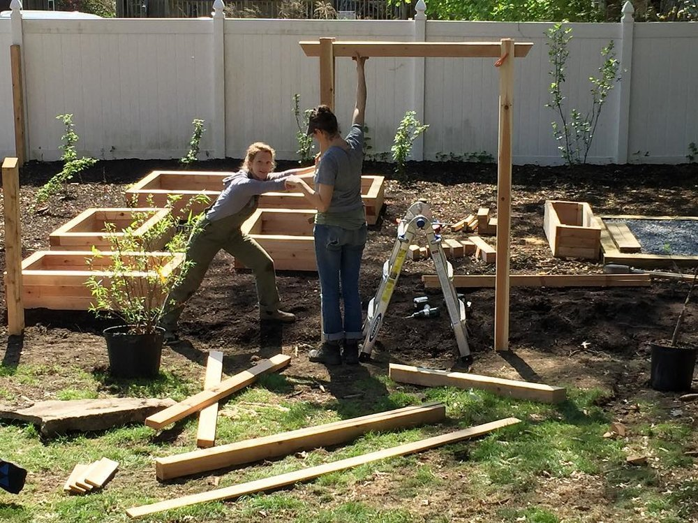 Setting the posts for an entryway into a fenced in agricultural area