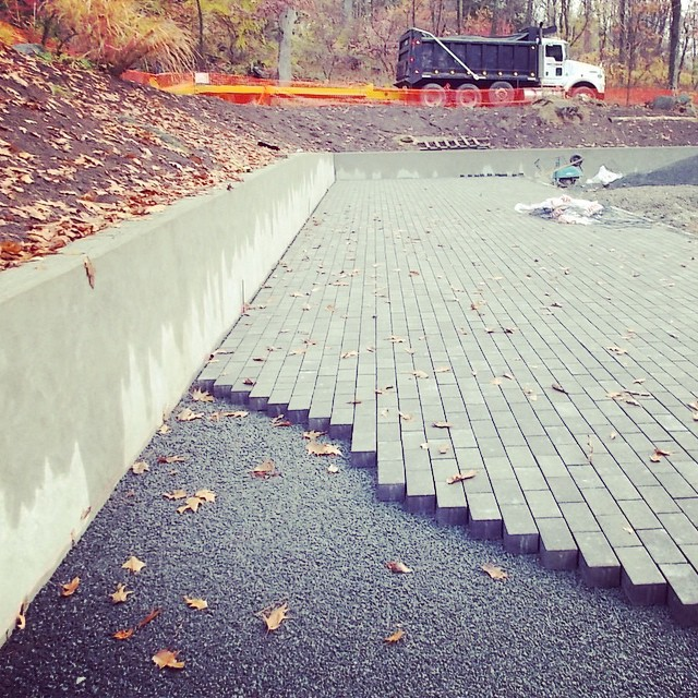 Finishing a parking lot made with permeable pavers at Mianus River Park