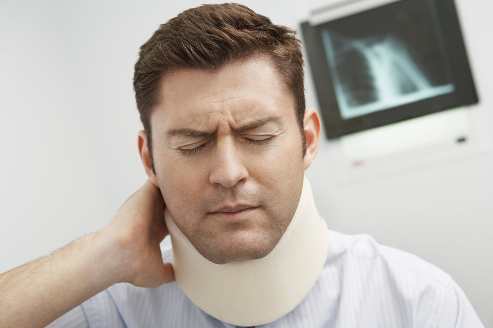 ..Man wearing neck brace in hospital - medium.jpg