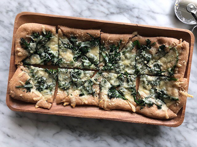 Lemony, garlicky, cheesy, broccolini-y. This flatbread is the perfect party appetizer. Or dinner... or lunch... or breakfast. Check out our link for the recipe! #julieandjesse