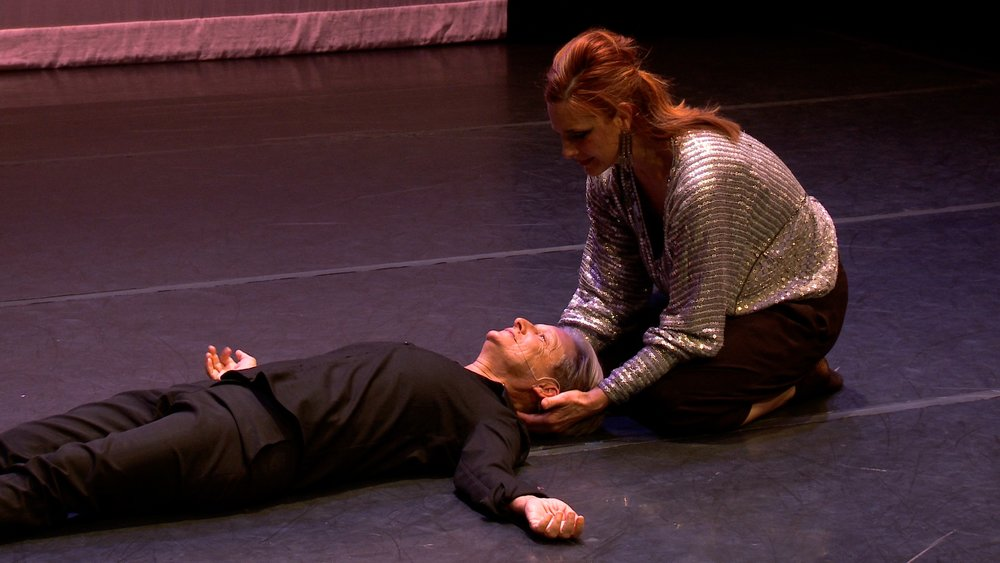 Monique Jenkinson holds Judith Butler's head in their premiere of  Ordinary Practices of the Radical Body .