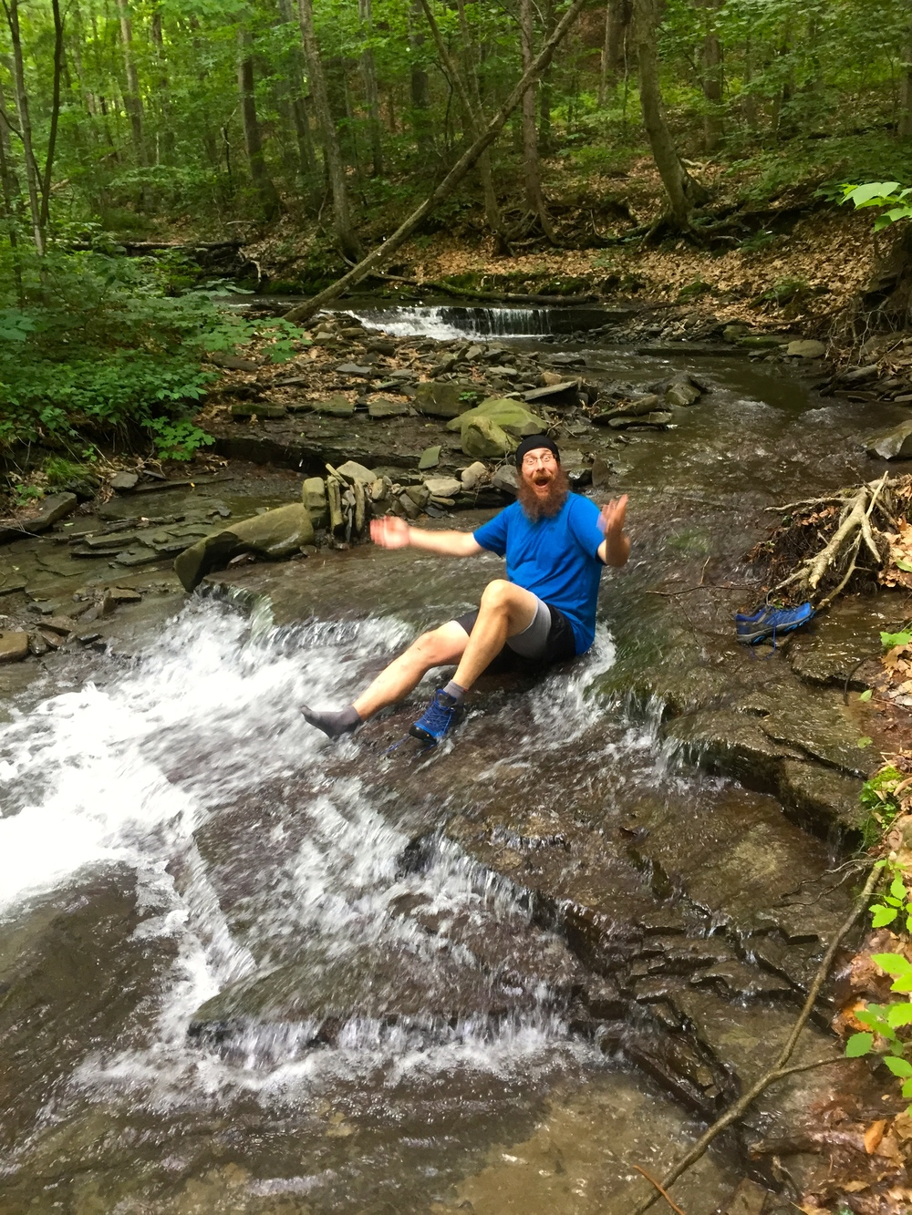 NoKey playing in a creek, washing off the mud and trying to escape the mosquitos!