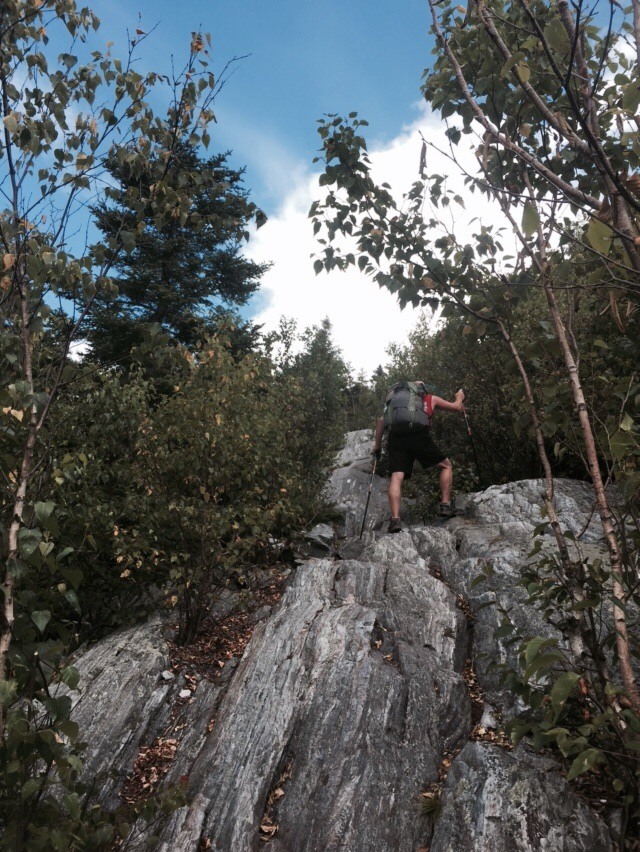 NoKey climbing Baker Peak.