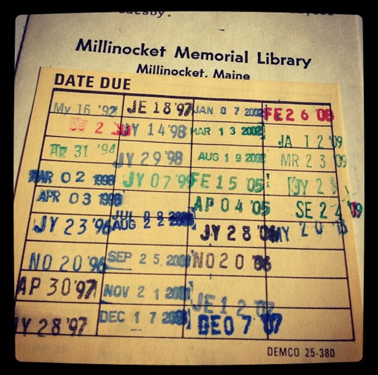 Checking out a book in the Millinocket Library - a blast from the past with the old school card system.