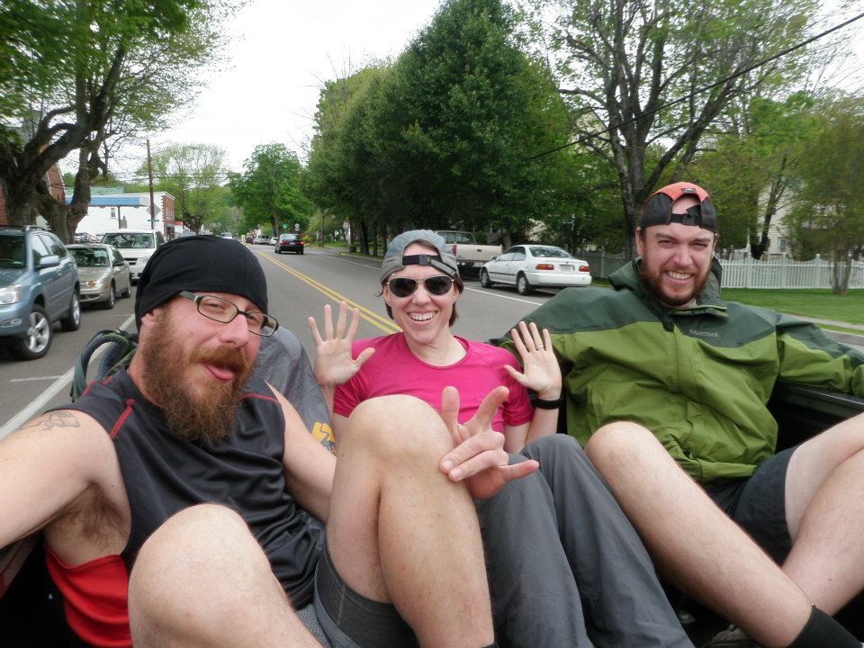 Hikers in the back of a truck, enjoying the free ride!