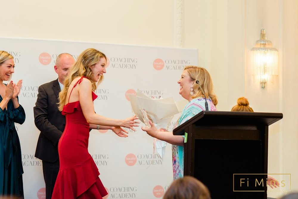 Receiving the Award from the Amazing Julie Parker, Director of Beautiful You Coaching Academy.