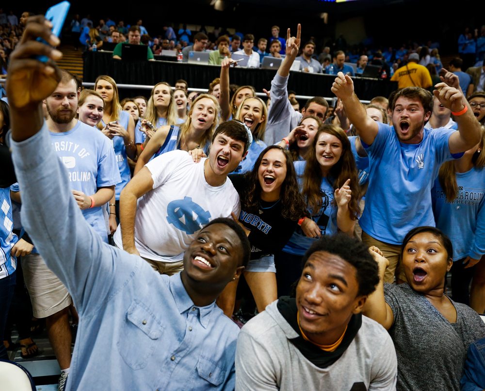 Rawle Alkins poses for a selfie with UNC fans during their preseason exhibition game against Guilford at the Dean Smith Center on Friday, Nov. 6, 2015. UNC defeated Guilford 99-49.