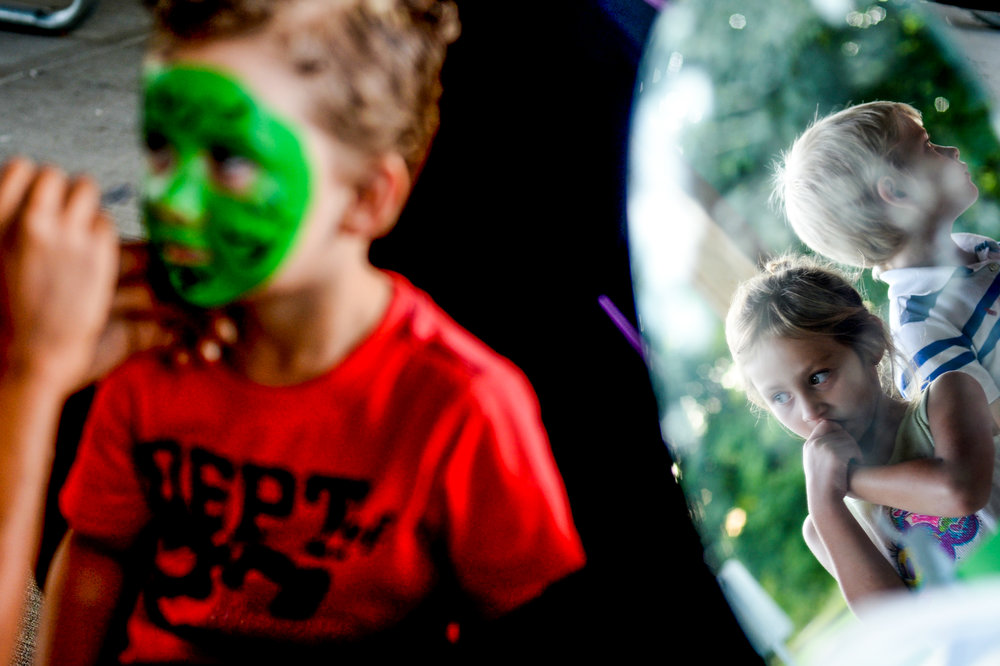 Kaylyn Bishop, 6, of Flint, and Jacob Kilpela, 7, of Clio, stand in line to get their faces painted during the End of Summer Celebration on Wednesday, Aug. 31, 2016 at For-Mar Nature Preserve and Arboretum in Burton.