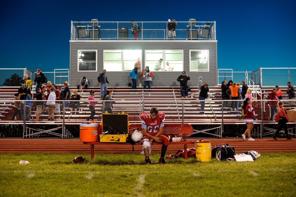 Bentley junior Joey Hoffner, No. 62, sits on the bench after he was injured in a game against New Lothrop on Thursday, Sept. 1, 2016 at Bentley High School in Burton. New Lothrop won 56-0.