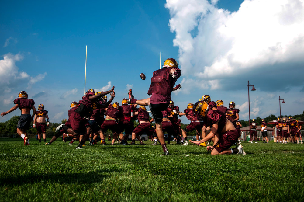 Davison High School players practice plays during their football workout on Tuesday, Sept. 6, 2016 in Davison.