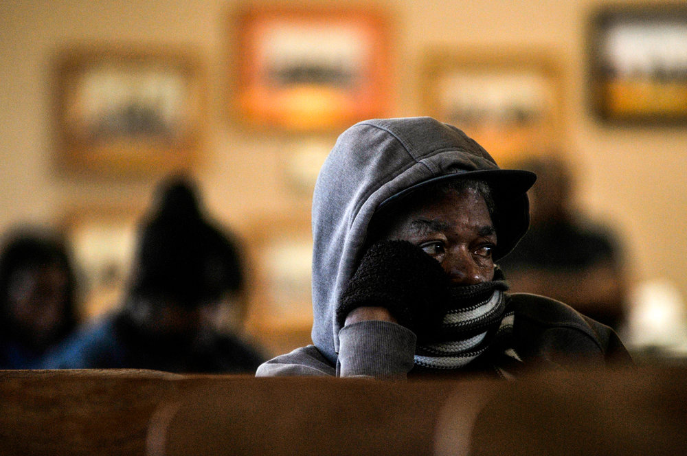 A Flint resident sits and listens to a town council meeting at City Hall on Monday, Sept. 26, 2016 in downtown Flint.