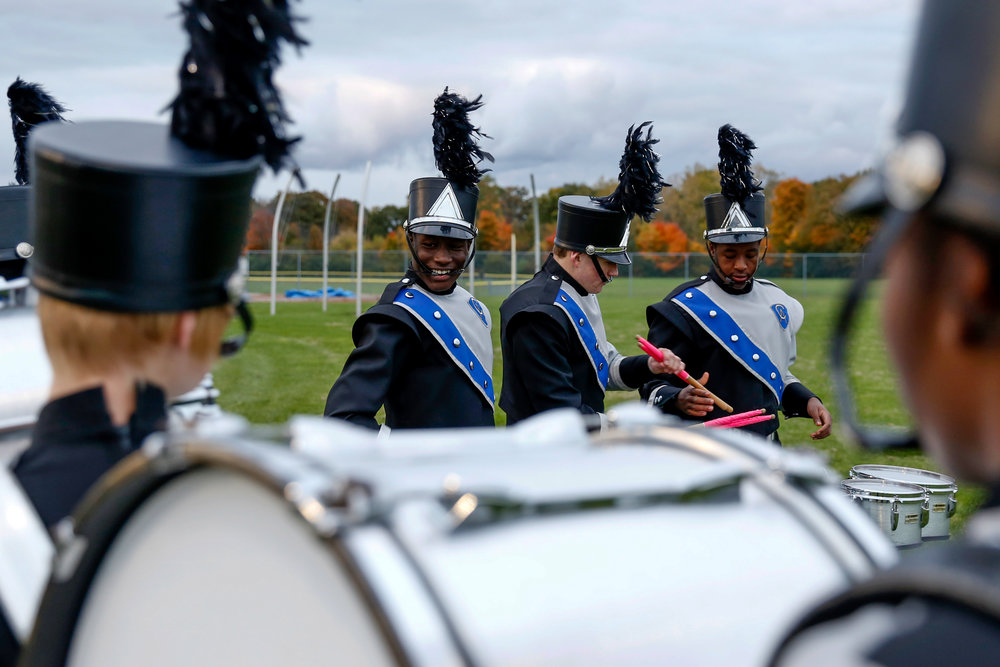 Carman-Ainsworth band members practice before the game against Lapeer High School on Friday, Oct. 21, 2016 at Carman-Ainsworth stadium in Flint. Lapeer defeated Carman-Ainsworth 24-14.