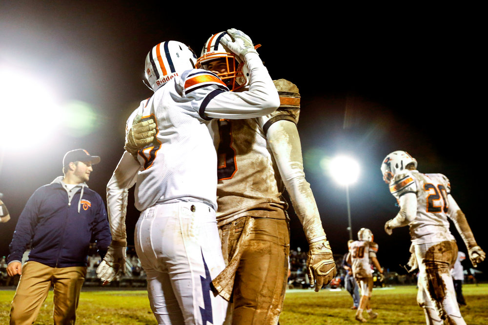 Powers Catholic High School players celebrate after making a risky play that led to the victory against Lake Fenton High School on Friday, Oct. 28, 2016 at Lake Fenton High School in Linden. Kaden Nelson caught a pitch and rushed a 3-yard touchdown that gave Powers the 20-19 win during the final minutes of the Division 4 playoff opener.