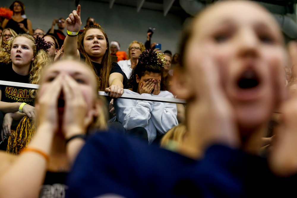 Students from Farmington Hills Mercy High School cheer on their friends swimming in the MHSAA D1 girls championship swim meet on Saturday, Nov. 19, 2016 at Oakland University in Rochester. Farmington Hills Mercy High School placed second after  Rockford High School was named the MHSAA D1 girls swimming champions.