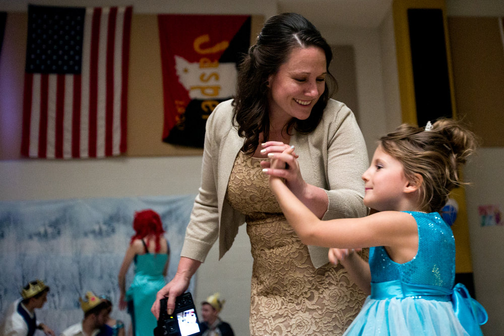 Mya Uebelhor of Huntingburg, 7, danced with her mother Sherri during Sunday afternoon's Grand Ball at Jasper Middle School. Northwood Retirement Community hosted the enchanted event where children dressed up and were taught to act and dance like princes and princesses.