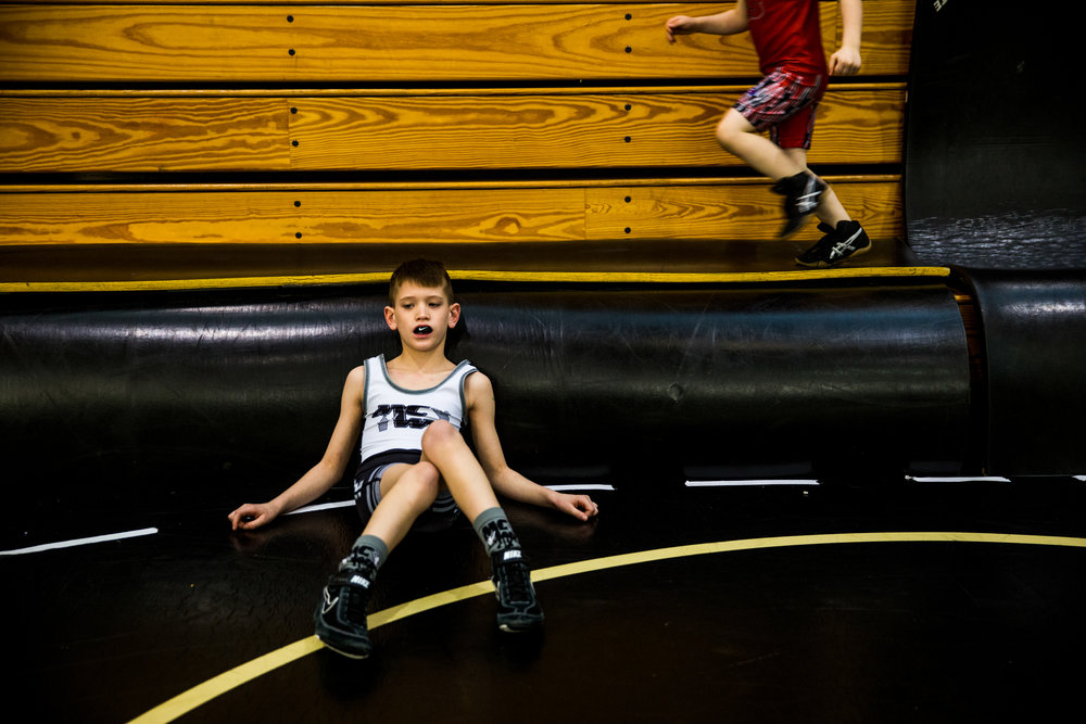 Isaac Dill of Fort Branch, 7, rested after warming-up during the 41st annual Folkstyle Open wrestling tournament at Jasper Middle School on Sunday. Children in age divisions pee wee through cadet competed in the event.