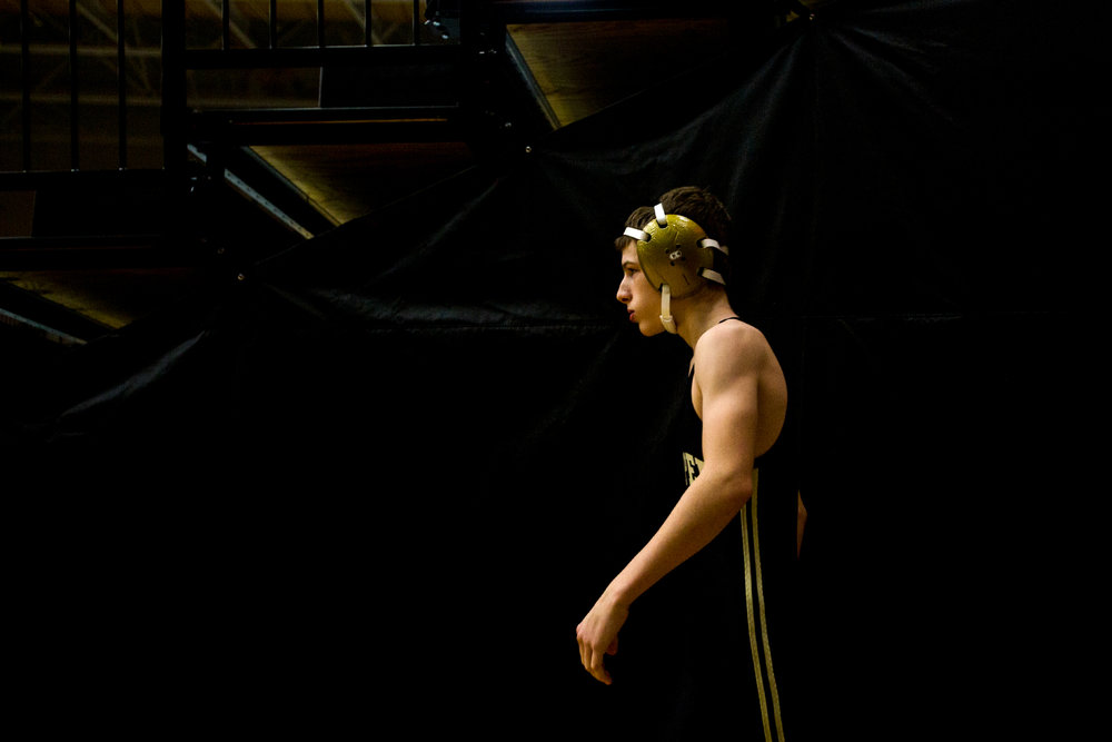 Jasper's Cameron Eckstein paced by the bleachers before his match during Saturday's wrestling match at Jasper Quad Duals in Jasper.