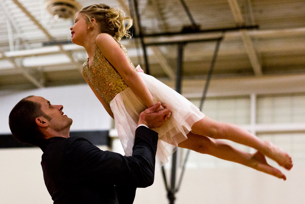 Rick Lyon of Jasper lifted his daughter, Sterling, 6, into the air while dancing during the second annual Daddy and Daughter Dance on Saturday evening at Jasper Middle School. Dance Central Academy's parent club sponsored the event that attracted more than 300 people.