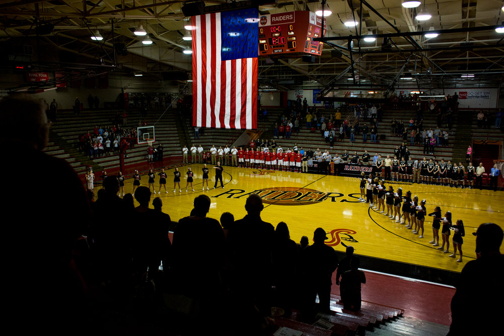 People stood for the playing of the national anthem before Friday night's game against Boonville at Memorial Gym in Huntingburg. Southridge defeated Boonville 56-54.