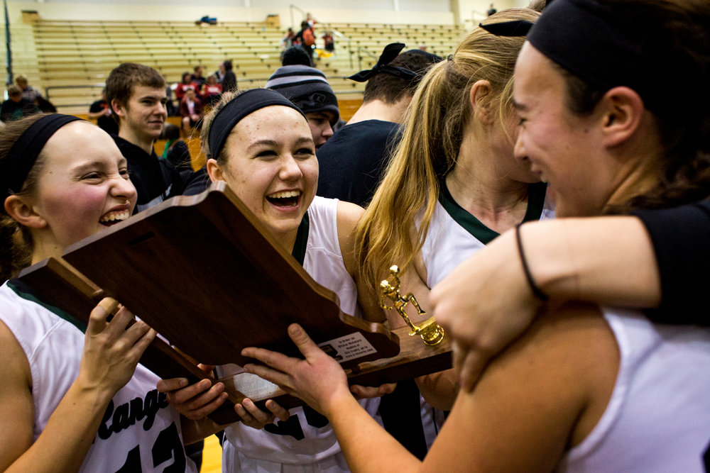 Forest Park's Samantha Jarboe, Lanette Blume, Erika Uebelhor and Emma Mehling celebrated after receiving the trophy from Saturday night's Class 2A girls sectional championship in Ferdinand. Forest Park defeated Tell City 45-35 in overtime and will advance to next week's regional championship in Paoli.