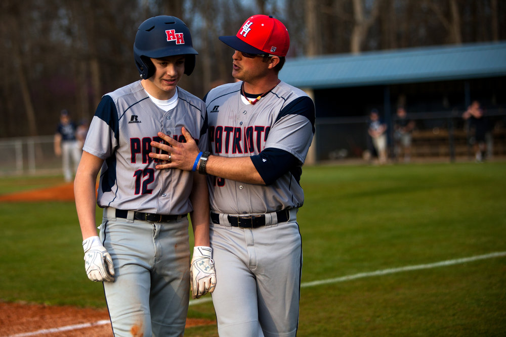 Heritage Hills head coach Greg Gogel talked to Cole Sigler after he was tagged out trying to take third base during Wednesday night's game at Heritage Hills High School in Lincoln City. Evansville Reitz defeated Heritage Hills 14-9.