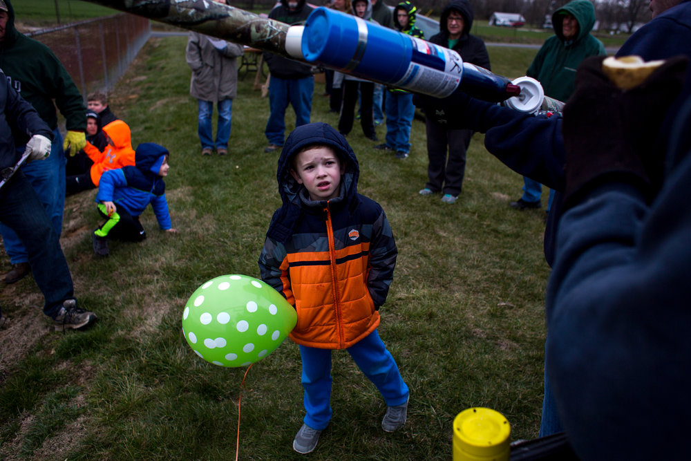 Carter Himsel of Jasper, 5, watched as his father, Jace, prepared to shoot a spud cannon outside Ireland Elementary School during Ireland's annual St. Patrick's celebration on Saturday.
