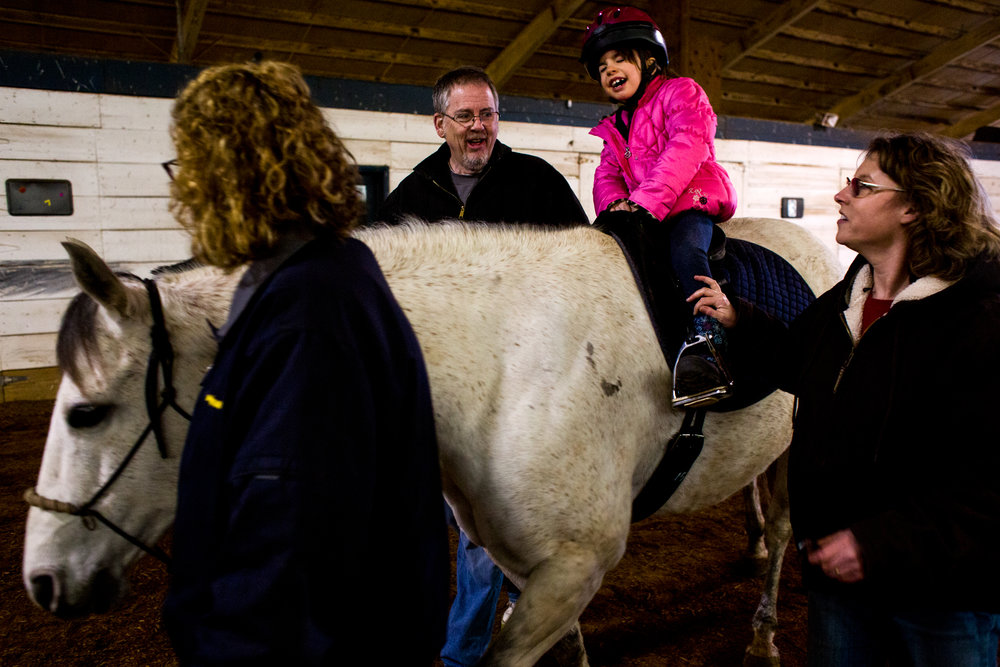 Charlotte Bradley of Ferdinand, 6, closed her eyes and counted to 10 before looking for a miniature horse figure that Hippotherapist Carrie Smith, right, had hidden in the barn during her hippotherapy lesson Thursday at Freedom Reins Therapeutic Riding Center in Jasper. Bradley has a genetic disorder called Prader-Willi syndrome, which includes symptoms like weak muscles and delayed development. Bradley began sessions with Smith last year as a way to improve coordination, balance and strength.
