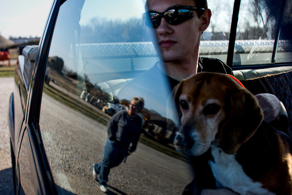 Zach Buechlein of Jasper, 17, watched his mother, Sheila, walk over as he sat with Clive for a moment before returning him to the shelter during the Dubois County Humane Society's Dog Day Out on Sunday afternoon in Jasper. The Dubois County Humane Society allows people to come to the shelter and check out a dog between 4:30-6:30 p.m. on Sundays.