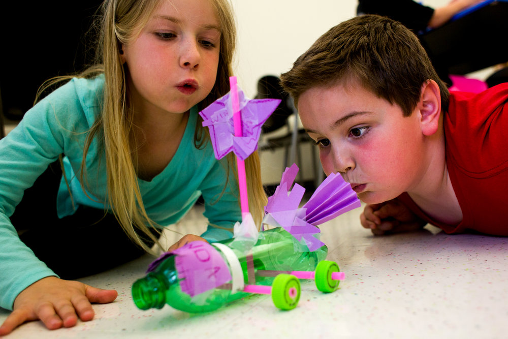 Lance Boeglin of Ferdinand, 8, right, helped Miranda Rickelman of Ferdinand, 8, blow on the sail of the wind-powered car she made during a STEAM (science, technology, engineering, art and math) activity Friday afternoon at Ferdinand Branch Library. The STEAM program offers a hands-on experience to help children solve problems and think creatively, said event organizer Natalie Abell.