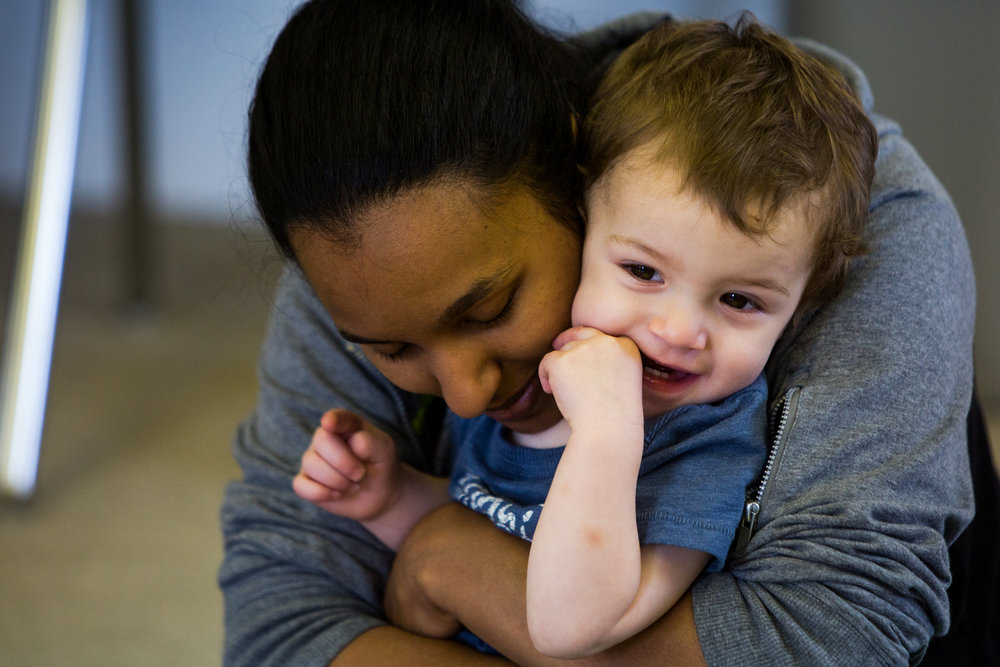 Rushine Moore of Jasper cuddled with her 16-month-old son Aleczander at the end of a Music Together class offered by Strings, Inc. on Thursday at the library annex in Jasper.