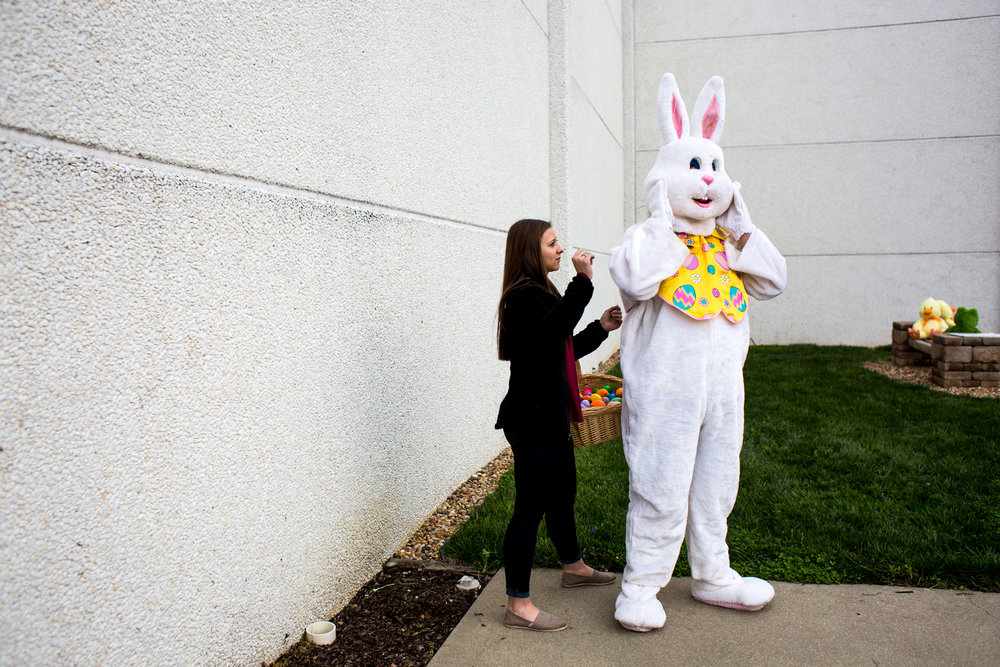 Kendyl Heeke, 15, helped Jackson Brosmer, 16, both of Celestine, adjust his bunny costume before the Easter egg hunt on Sunday at St. Celestine Catholic Church. The sophomore class from both St. Isidore Parish campuses volunteered to hide Easter eggs and dress up as the Easter bunny to serve the children of the congregation after the 8 a.m. Mass.