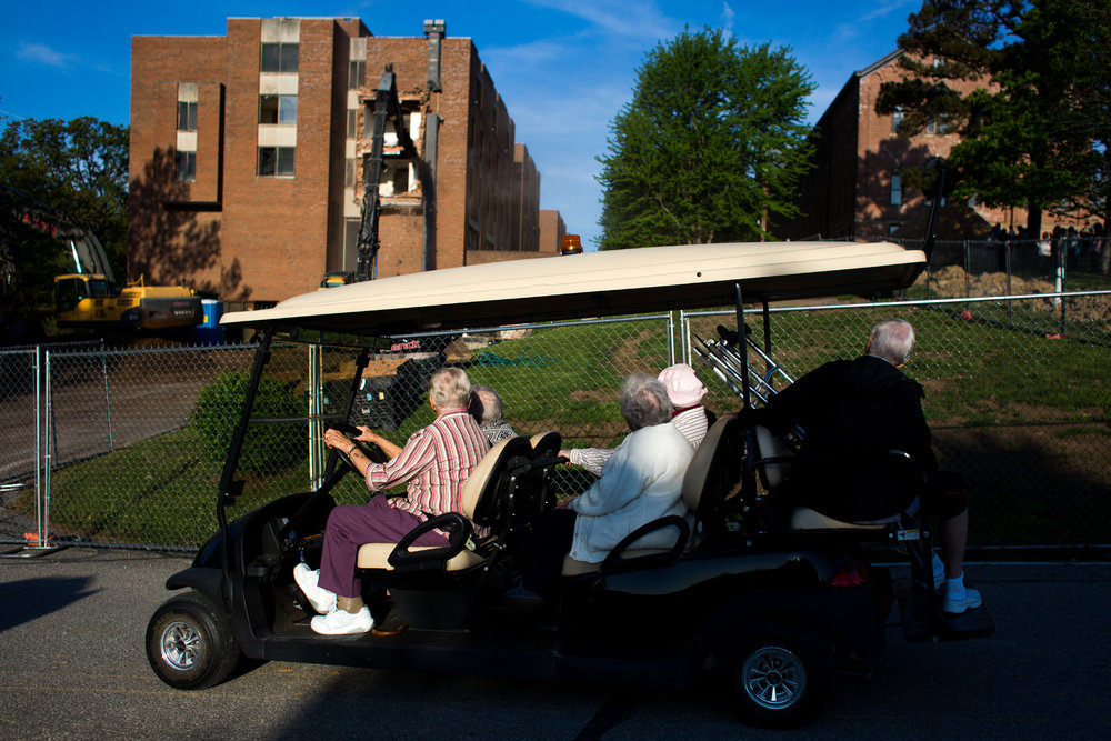 Sister Geneva Stumler, 84, drove fellow sisters Helen Maurer, 95, Theresita Schenk, 96, Dolorita Libs, 96, and Mary Claude, 86, to watch the demolition of Madonna Hall on Tuesday morning on the grounds of Monastery Immaculate Conception in Ferdinand. The five-story residence hall was built in 1968 and home to the Sisters of St. Benedict's Marian Heights Academy, which closed in 2000. The Sisters explored a multitude of alternative options such as turning Madonna Hall into a nursing home or letting Ivy Tech's network of community colleges repurpose the hall for its own use. None of those options reached fruition. The Sisters of St. Benedict will celebrate their 150th anniversary this summer.