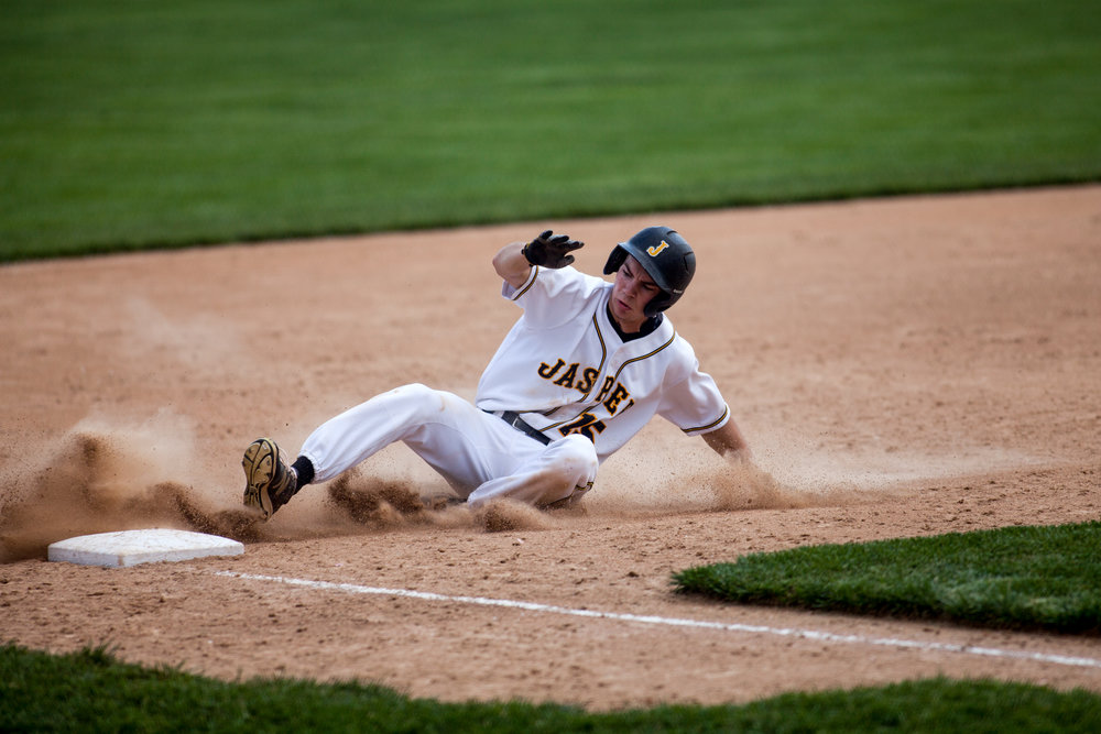 Jasper's Eric Nordhoff slid into third base during Saturday's game against New Albany in Jasper. Jasper defeated New Albany 6-4.