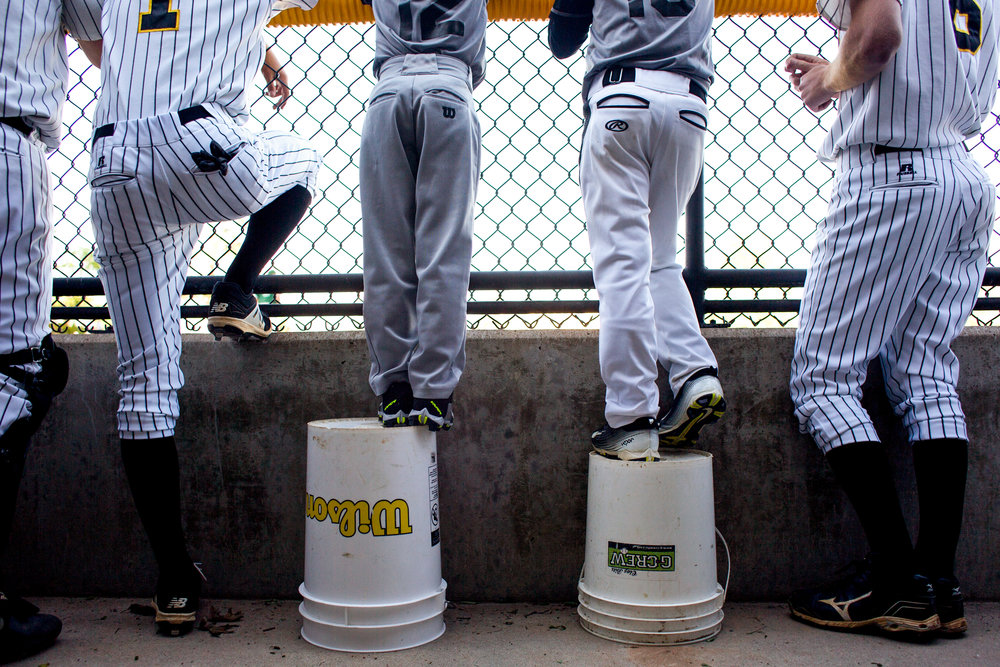 Jasper's ball boys Nicolas Aguilera and Sutton Brosmer, both 8, stood on buckets while watching Jasper bat during Tuesday night's game against Forest Park at Ruxer Field in Jasper. Jasper defeated Forest Park 14-1.