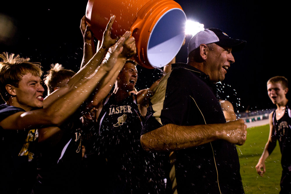 Jasper boys track members dumped water on Coach Kevin Schipp after being announced the boys track sectional champions at Perry Central High School in Leopold.