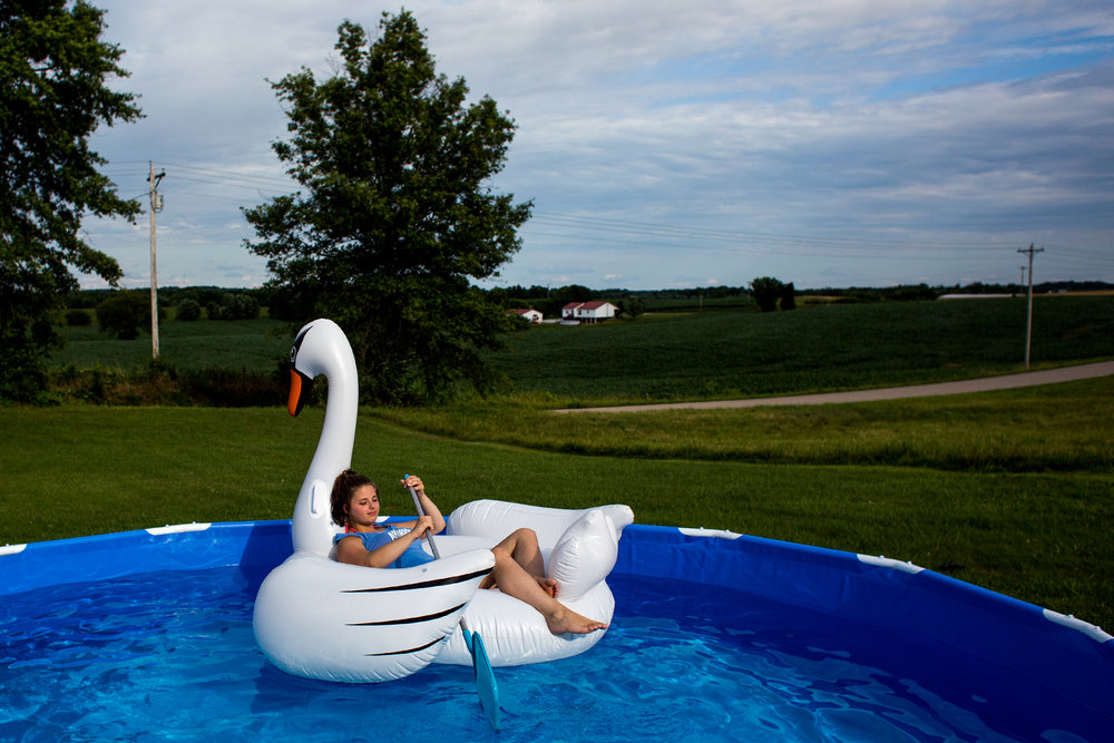 With a cool breeze, temperatures in the 70s and a water temperature of 74 degrees, Natasha Ward of Jasper, 16, opted out of an afternoon swim Monday. Instead, she stayed dry by relaxing on an inflatable swan in her family's new pool.