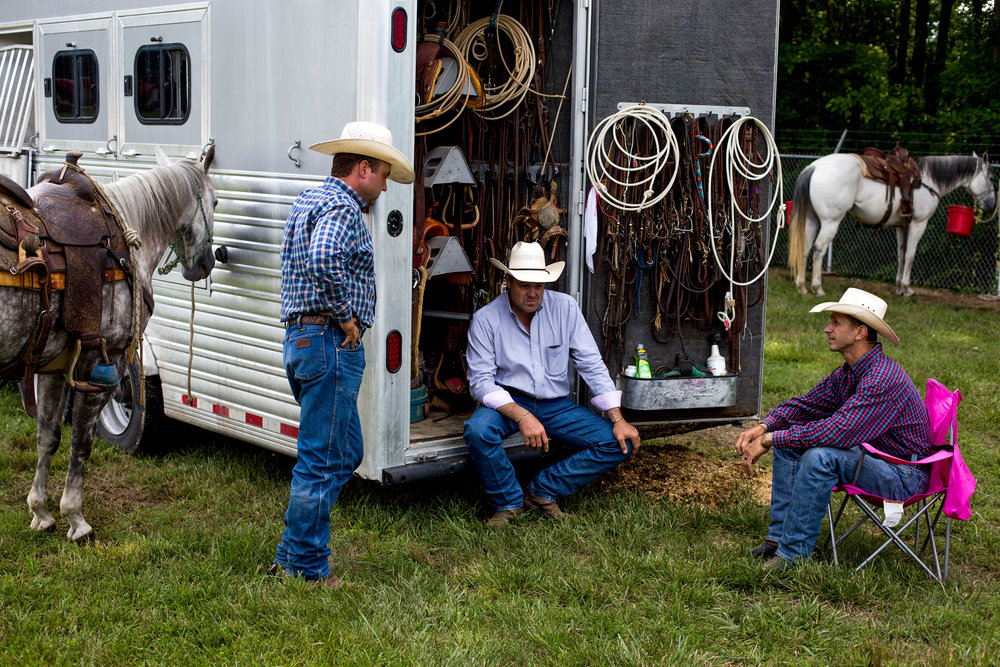 John Davidson of Adams, Tenn., from left, Clint Madison of Crofton, Ky., and Bradley Boyd of Princeton, Ky., talked before the Lone Star Rodeo on Saturday at the Dubois County 4-H Fairgrounds in Bretzville.
