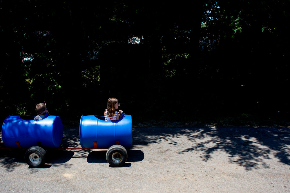 Ava Fessler of Huntingburg, 7, turned to look behind her as she rode in the caboose of the barrel ride during the town of Stendal's sesquicentennial celebration Saturday.