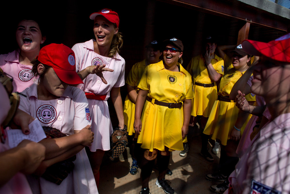 "The Rockford Peaches and the Racine Belles chatted in the dugout together before playing at League Stadium on Saturday in Huntingburg during the 25th anniversary celebration of ""A League of Their Own."" The Peaches and Belles tied 8-8 during the 1940s-themed rematch."