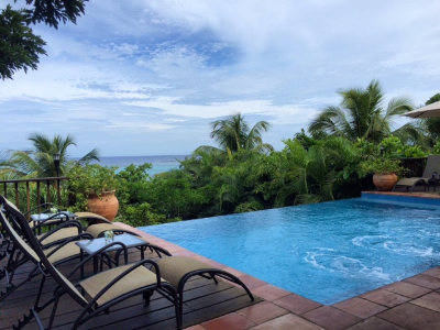 Relaxing by the pool at Mayoka Lodge, Roatan, Honduras.