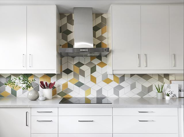 That feeling when you need a little something more in your kitchen. These unique patterned tiles were the perfect accent for this bright white kitchen design. Patterned tiles do wonders to modernize a space without sacrificing traditional form and function. . . . . #carriagelanedesigns #interiordecor #interiores #interiorstyling #interiorstyle #actualinstagramhomes #housebeautiful  #myinteriorstyletoday #interior_and_living #instahome #instadesign #homestyling #instainterior #interiorforinspo #myhouse  #interiorinspo #interior4inspo #dream_interiors #charminghomes #interior_delux #bloglovinhome #simplystyleyourspace #howyouhome #styleithappy