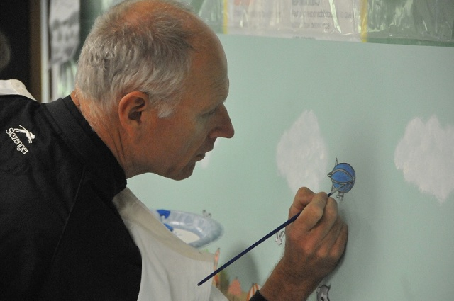 Monsignor adds to the mural