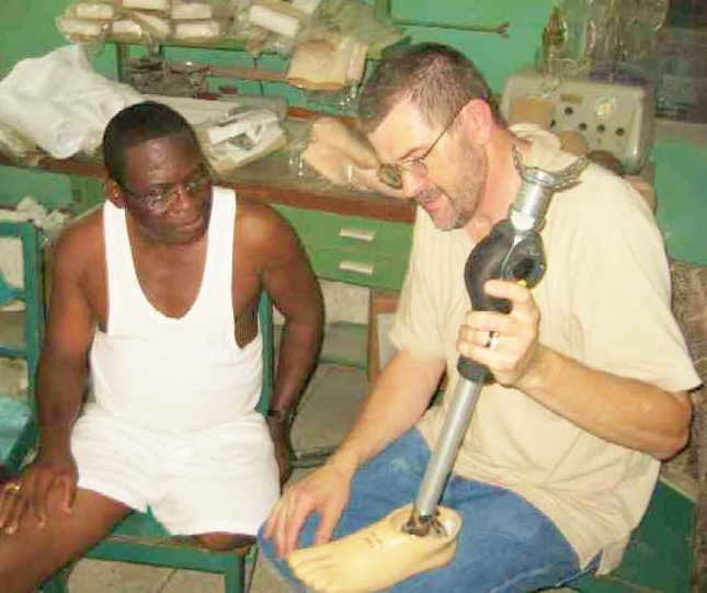 Kraig with patient in Ghana