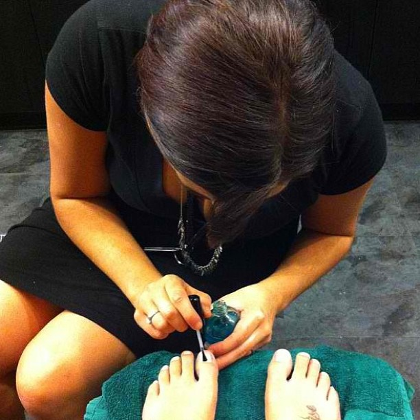 This is a real life- unglamorous- photo of my giving my BFF a pedicure when I was in cosmetology school, you're welcome.