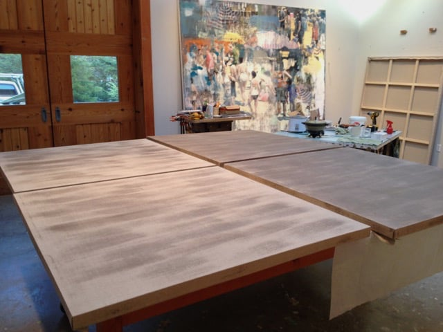Buller prepping his stretched linen surfaces with Rabbit Skin glue